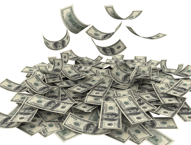 Image of hundred dollar bills falling into a pile